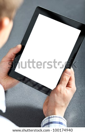 man holding in hands a touch pad tablet gadget. - stock photo