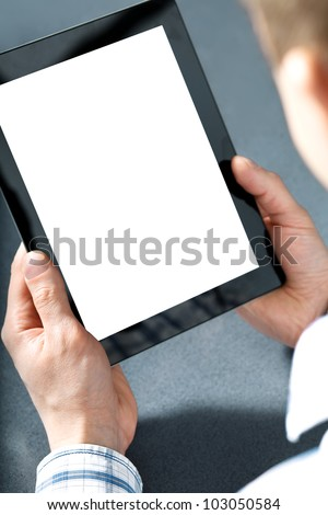 man holding in hands a touchpad tablet touch pad computer gadget. - stock photo