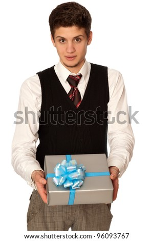 man holding in the hands the gray box with blue ribbon as a gift - stock photo