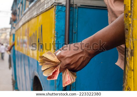 Man holding Indian rupee notes - stock photo