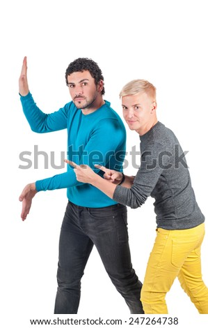 Man holding invisible wall, another one showing - stock photo