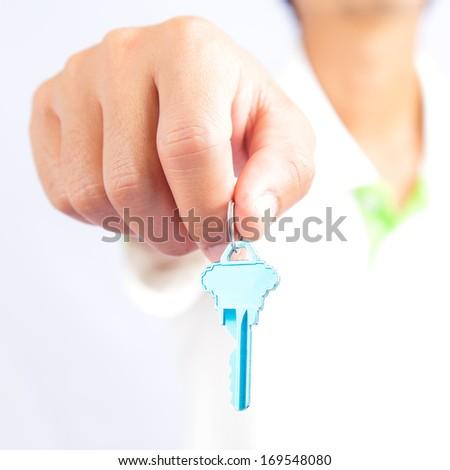 Man holding key - stock photo