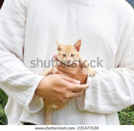 man holding kitten. - stock photo