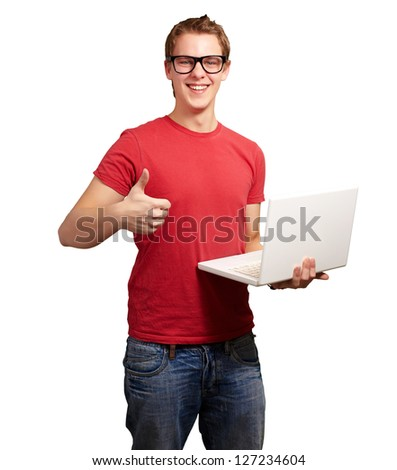 Man holding laptop with thumbs up isolated on white background