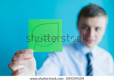 man holding leaves icon - stock photo