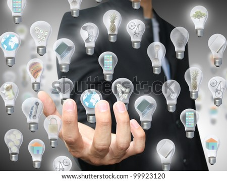 Man holding light bulb object