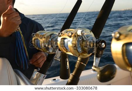 Man holding lure while deep sea saltwater fishing - stock photo
