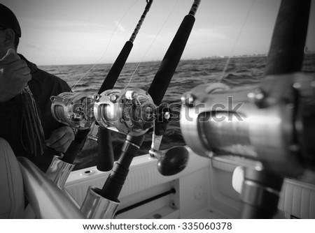 Man holding lure while deep sea saltwater fishing in the Atlantic Ocean - stock photo