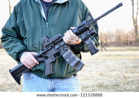 Man holding M4 Rifle - stock photo