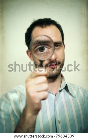 Man holding magnifying glass  portrait