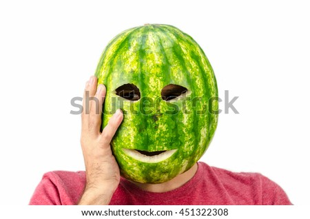 man holding mask of fruit or watermelon over his face - stock photo