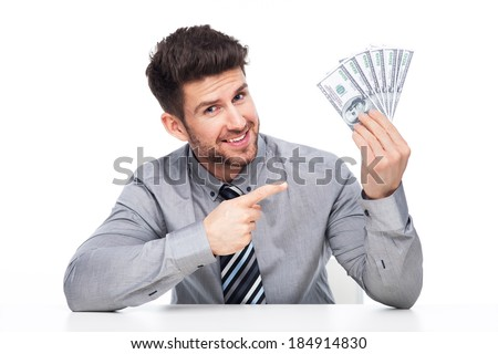 Man holding money  - stock photo