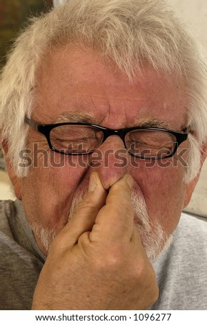 Man holding nose because of bad smell