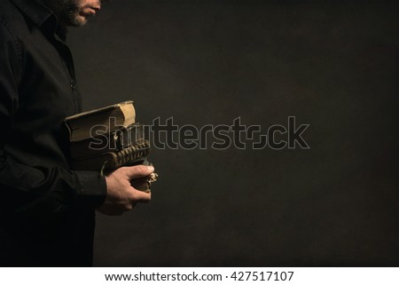 Man holding old Books in his Hands