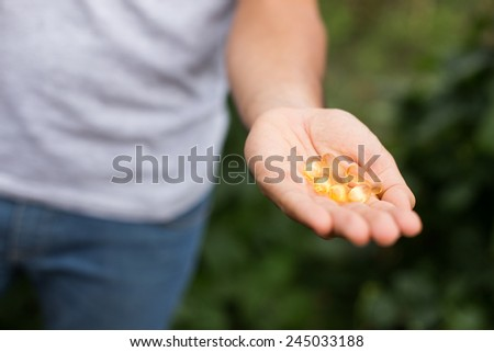 Man holding omega 3 pills in his hand.