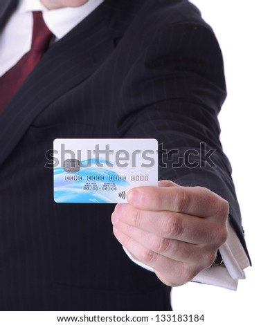 man holding out a credit debit card with copy space isolated on white background - stock photo