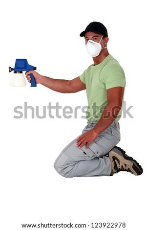 Man holding paint sprayer - stock photo