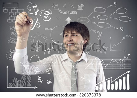 man holding pen and writing something