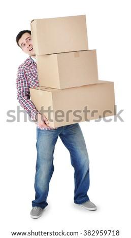 Man holding pile of carton boxes isolated on white background - stock photo