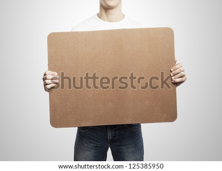 man holding placard on a white background - stock photo