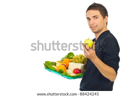 Man holding plateau with healthy food and choose green apple to eat isolated on white background - stock photo