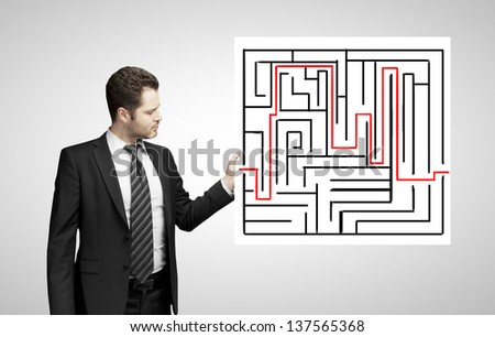 man holding poster with maze - stock photo