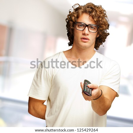 Man Holding Remote Control, Indoor - stock photo