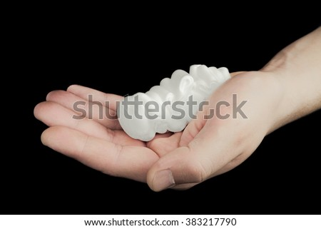 Man holding shaving foam on the palm.. Objects on a black background with limited depth of field. - stock photo