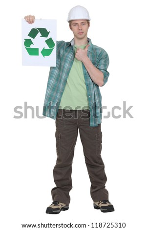 Man holding sign with recycling symbol - stock photo