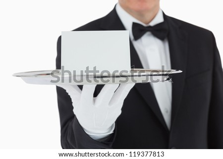 Man holding silver tray with white blank card