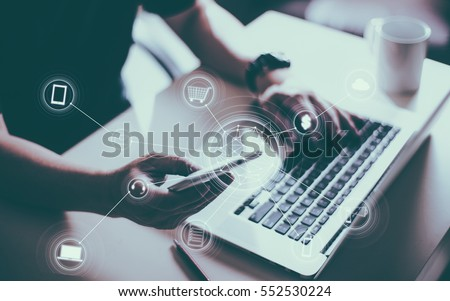 Man holding smart phone making online shopping and banking payment. Blurred background .