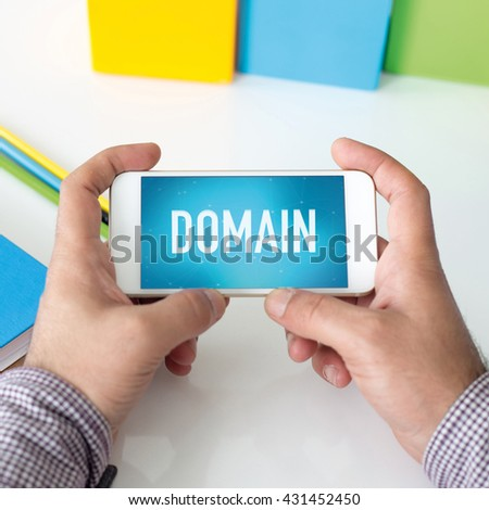 Man holding smartphone which displaying Domain - stock photo