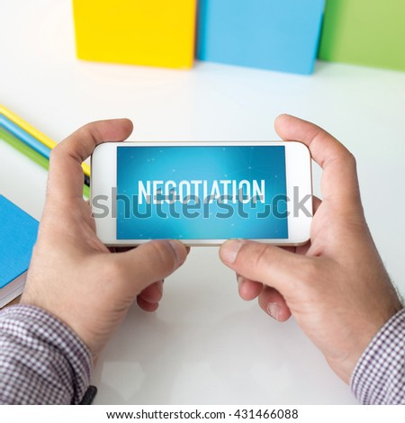 Man holding smartphone which displaying Negotiation - stock photo