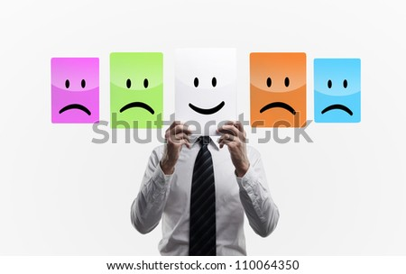 man holding smilies  on a white background - stock photo