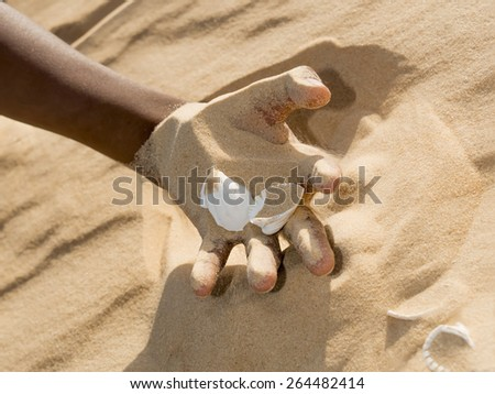 Man holding some sand in the hand  - stock photo