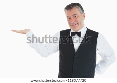 Man holding something in his hand - stock photo