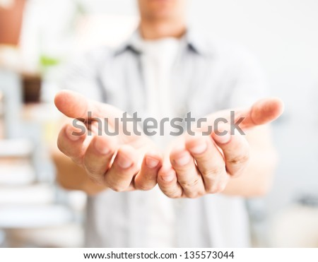 Man holding something in his hands - stock photo