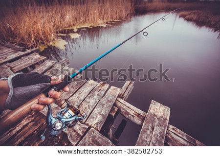Man holding spinning fishing on the river