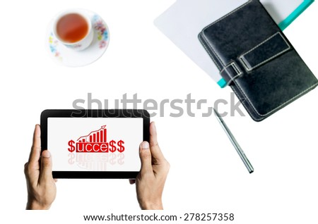 Man holding tab in hand isolated in white background showing business graph,pen,cup of tea and notebook - stock photo