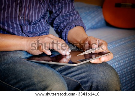 Man holding tablet and credit card. Shopping Online