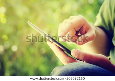 Man holding tablet in the park