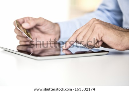 Man holding tablet pc and credit card indoor, Shopping Online - stock photo