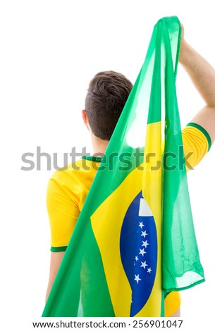 Man holding the Brazilian flag