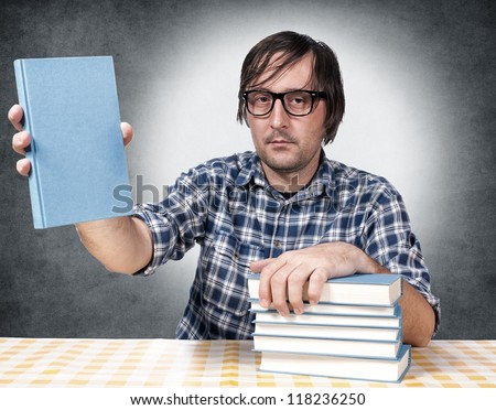 Man holding the cover side of blank book - stock photo