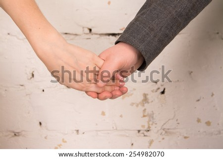 man holding the hand of his woman