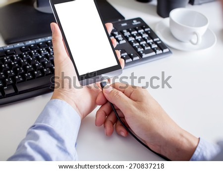 Man holding the phone with charging battery
