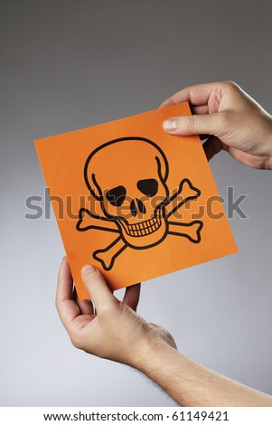 Man holding the symbol for poison in his hands.