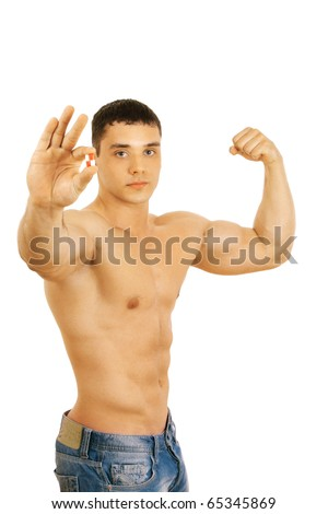 man holding two pills isolated on white background - stock photo