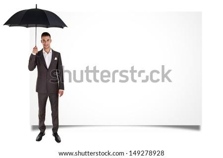 Man holding umbrella and blank board - stock photo