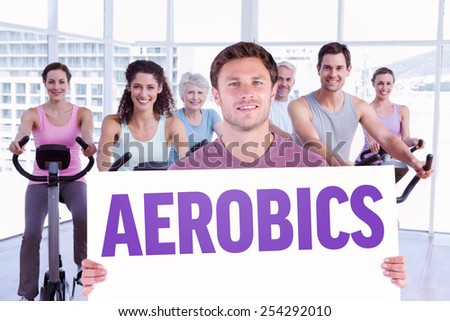 Man holding up a sign against aerobics - stock photo